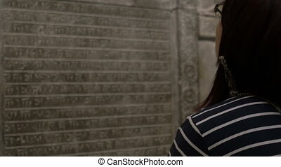 Girl Looking At Sumerian Inscription - Girl is looking to...
