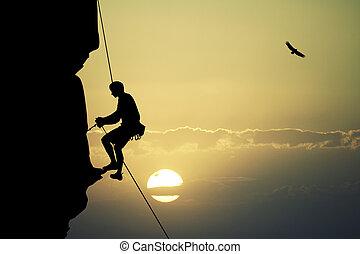 man climber at sunset