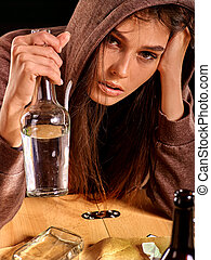 Drunk girl holding bottle of vodka. - Drunk girl drinking of...