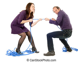 fighting couple - mature couple fighting together pulling...