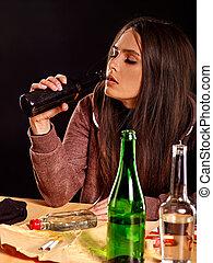 Drunk girl holding bottle of vodka. - Drunk girl with long...