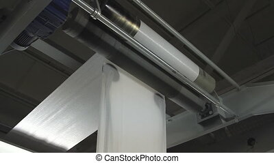 paper roll unreel for a printing press - Big paper roll...