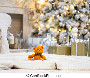 Brightly lit christmas tree with toy bear - Brightly lit...