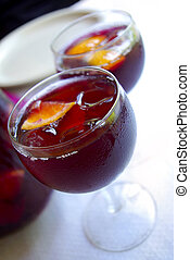Cups with Sangria - Two glass cups filled with fresh tasty...