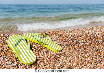 Flip flops at the beach - summer vacation with flip flops at...