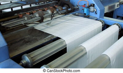 polymeric tape roll unreel for a printing press - Big...