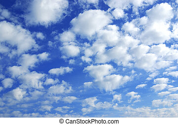 Fluffy Clouds - Many white fluffy clouds over a deep blue...