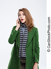 Amazed woman talking on the phone