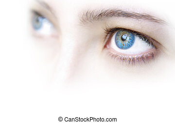 Blue Eyes - Close up view of a young woman\'s beautiful blue...