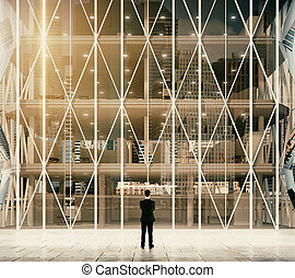 Businessman in front of entrance to the modern vitreous business center