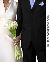Just Married - Grooms black suit and brides white wedding...