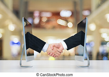 Computer communication concept with human handshake