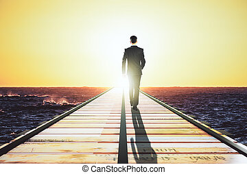 Businessman is walking on pier to meet light concept