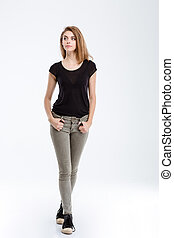 Casual thoughtful woman looking away - Full length portrait...