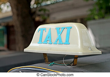 old taxi sign on roof top car - old taxi sign on roof top...