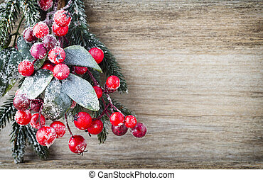 Christmas wreath from red berries, a fur-tree and cones.