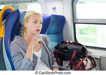 Blonde business woman traveling by train. - Blonde caucasian...