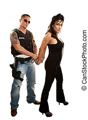 Handsome cop arresting pretty Latina woman - Handsome...