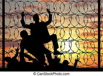 Silhouette of refugees crossing the border illegally -...