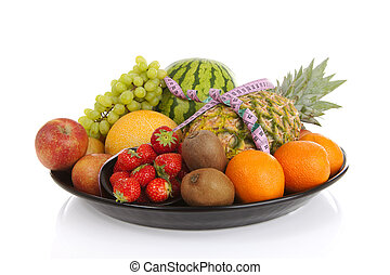 Big plate with lots of healthy fruits andmeasure tape