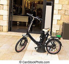 Electric bike near open door of shop