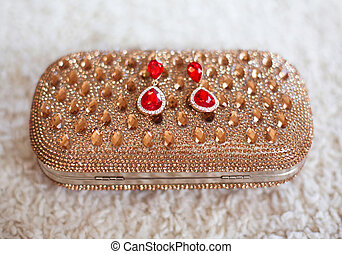 fashion earrings style red jewels with diamonds on golden...