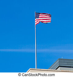 the American flag on top of the US Embassy in Berlin. - the...