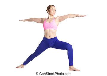Virabhadrasana 2 pose - Sporty beautiful young blond woman...