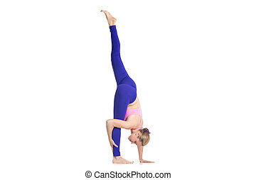 Standing split yoga pose - Sporty beautiful young blond...