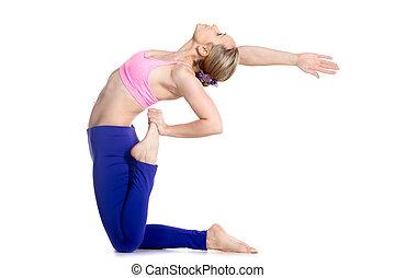 Yogi female doing one-legged Camel Pose - Sporty beautiful...