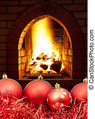 red Christmas balls and tinsel with fireplace - red...