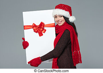 Woman in Santa hat holding white banner - Christmas, Xmas,...