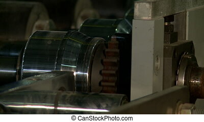 Rotating mechanism of operated production machine, close-up