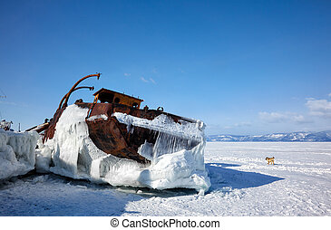 Old frozen ship on the bank of Olkhon island on lake Baikal...