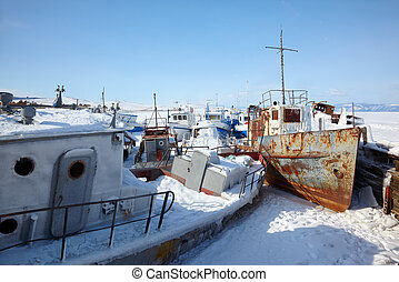 Old frozen ships in the port of Olkhon island on siberian...