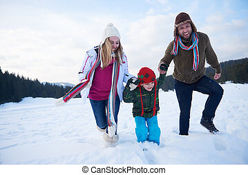 happy family playing together in snow at winter - happy...