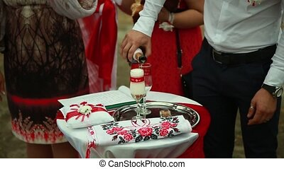 Groom pours a glass of champagne at a wedding