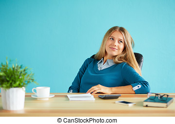 Pretty smiling business woman resting in office