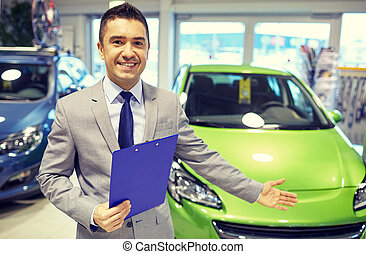 happy man at auto show or car salon - auto business, car...