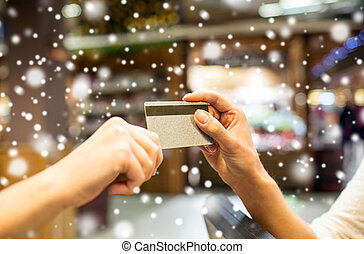 close up of hands giving credit card in mall - sale,...