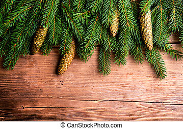 Tree branches on wooden background - Close up of fir tree...
