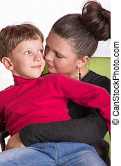 the boy and the girl embraced - The boy sat in a lap at the...