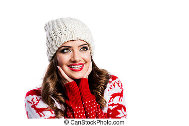 Beautiful young woman in red sweater. Studio shot on white...