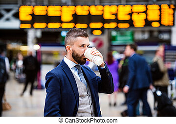 Businessman with coffee cup - Young handsome businessman...