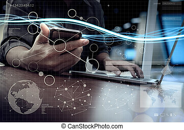 Waves of blue light and businessman using on laptop computer as concept