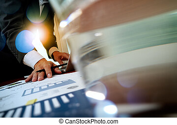 business man hand working on laptop computer with business...
