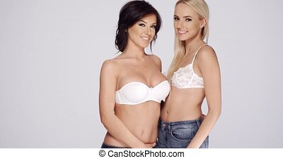 Sexy Ladies Wearing White Bras and Jeans - Half Body Shot of...