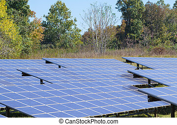 Photovoltaic power solar farm - Solar panel array on a...