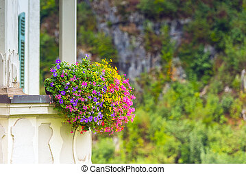 House facade with balcony and flowers