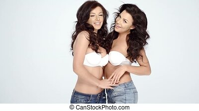 Two sexy women modelling strapless bras - Two sexy shapely...